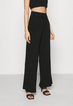 NA-KD - NA-KD X ZALANDO EXCLUSIVE SOFT RIBBED PANTS - Bukse - black