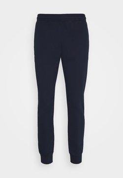 Lacoste - Jogginghose - navy blue