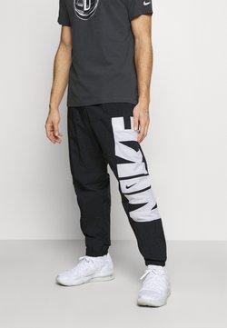 Nike Performance - STARTING PANT - Jogginghose - black/white