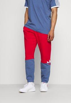 adidas Originals - SLICE - Jogginghose - scarlet/crew blue