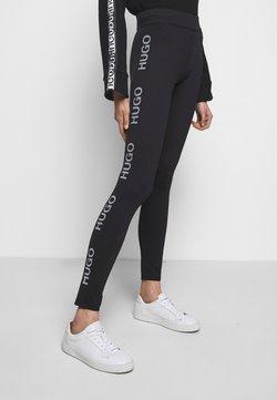 HUGO - NEFLECTIVE - Leggings - Trousers - black
