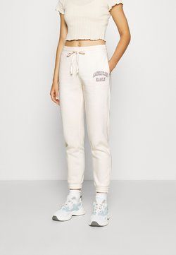 American Eagle - INTERNATIONAL BRANDED JOGGER - Jogginghose - toasted coconut