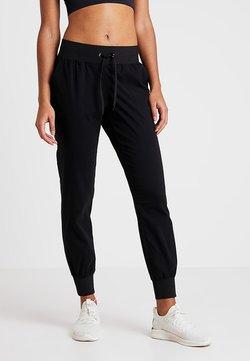 Casall - COMFORT PANTS - Verryttelyhousut - black