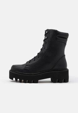 NA-KD - HIGH PROFILE LACE UP BOOTS - Enkellaarsjes met plateauzool - black