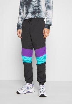 Urban Classics - CRINKLE TRACK PANTS - Jogginghose - black/ultraviolet/aqua