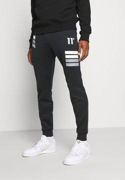 11 DEGREES - NANO REFLECTIVE STRIPE TRACK PANTS - Jogginghose - black