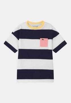 Lacoste - T-Shirt print - flour/navy blue