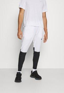 Nike Performance - SWIFT PANT - Jogginghose - white/black