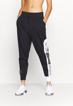 Puma - TRAIN STRETCH TRACK PANT - Verryttelyhousut - black/white