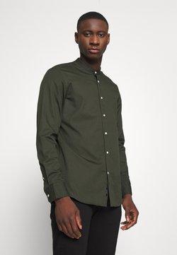 Calvin Klein - STAND COLLAR LIQUID TOUCH - Chemise - green