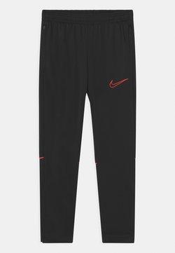 Nike Performance - UNISEX - Pantalon de survêtement - black/siren red