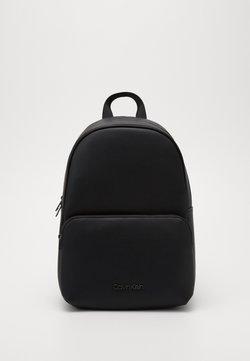 Calvin Klein - CENTRAL ROUND BACKPACK - Reppu - black