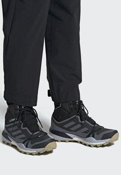 adidas Performance - TERREX SKYCHASER GORE-TEX BOOST HIKING SHOES - Obuwie górskie - black