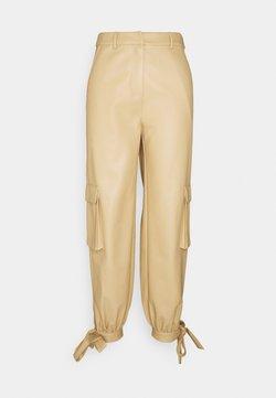 NA-KD - TIED HEM PANTS - Cargo trousers - beige