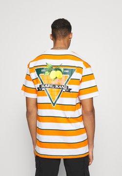 Karl Kani - SMALL SIGNATURE STRIPE TEE UNISEX - T-Shirt print - orange