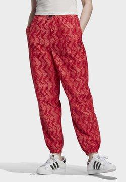 adidas Originals - ALLOVER PRINT TRACKSUIT BOTTOMS - Jogginghose - red