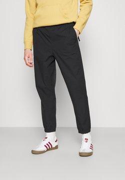 Carhartt WIP - HURST PANT - Jogginghose - black