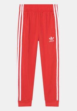 adidas Originals - SUPERSTAR TRACK ADICOLOR UNISEX - Pantalon de survêtement - red/white