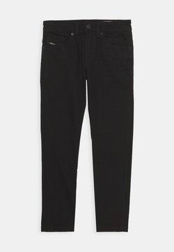 Diesel - THOMMER-J PANTALONI - Jeans Skinny Fit - denim nero