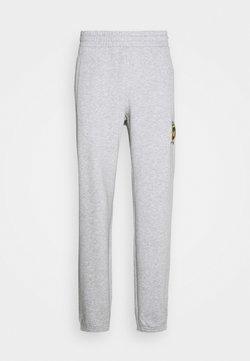 adidas Originals - COLLEGIATE CREST UNISEX - Jogginghose - light grey