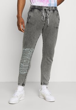 The Couture Club - COUTURE WAVE PRINT RELAXED JOGGER - Jogginghose - grey acid wash