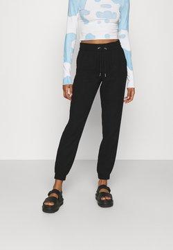 ONLY - ONLKELDA EMERY PULL UP PANTS - Jogginghose - black