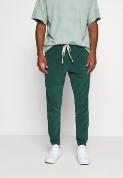 WRSTBHVR - TRACKPANTS LOUNGIN - Jogginghose - green/off white