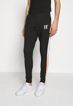 11 DEGREES - PANEL BLOCK TRACK PANTS - Jogginghose - peach melba/black/white