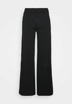 BLANCHE - EXCLUSIVE HELLA SLIT PANTS - Jogginghose - black
