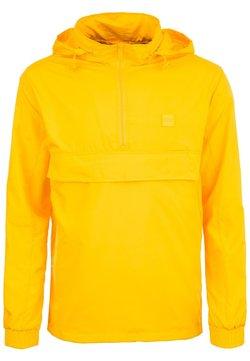 Urban Classics - Regenjacke / wasserabweisende Jacke - chrome yellow