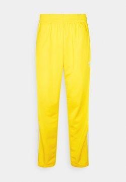 adidas Originals - FIREBIRD UNISEX - Jogginghose - yellow