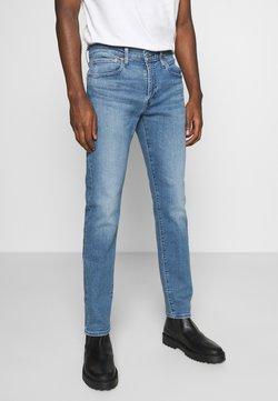 Levi's® - 512™ SLIM TAPER - Jeans Tapered Fit - med indigo