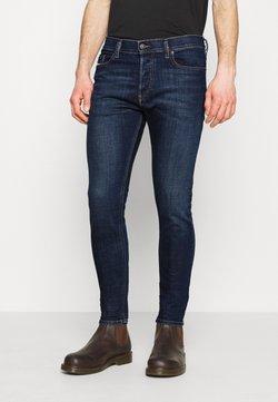 Diesel - D-LUSTER - Slim fit jeans - dark blue