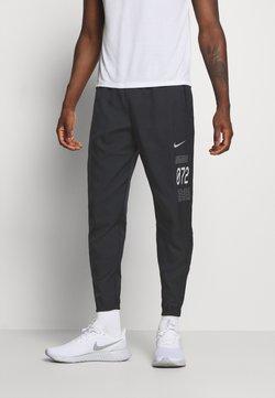 Nike Performance - PANT - Pantalones deportivos - black/silver