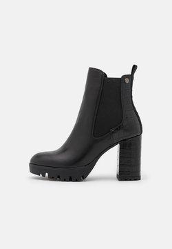 XTI - Platform ankle boots - black