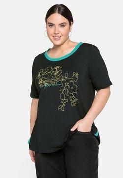 Sheego - T-Shirt print - schwarz bedruckt