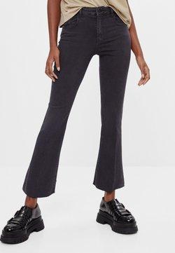 Bershka - SCHLAGHOSE - Flared Jeans - black