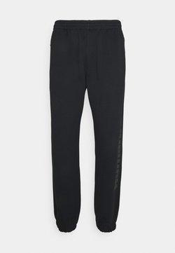 adidas Originals - PHARRELL UNISEX - Jogginghose - black