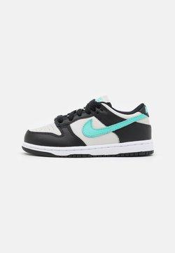 Nike Sportswear - DUNK UNISEX - Sneakersy niskie - light bone/tropical twist/black/white