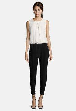 Vera Mont - MIT CUT-OUTS - Jumpsuit - black/cream