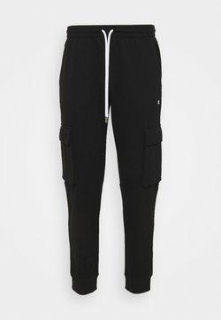 Champion - CUFF PANTS - Jogginghose - black