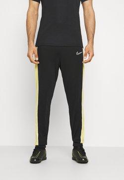Nike Performance - ACADEMY PANT - Jogginghose - black/saturn gold/white
