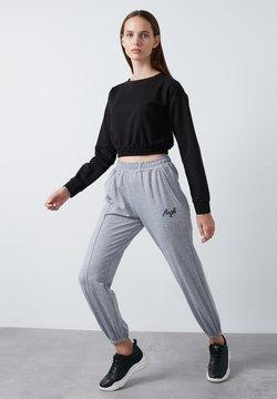 LELA - Jogginghose - grey
