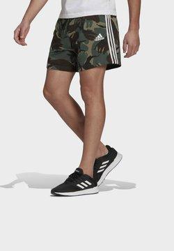 adidas Performance - ESSENTIALS FRENCH TERRY CAMOUFLAGE SHORTS - Urheilushortsit - green