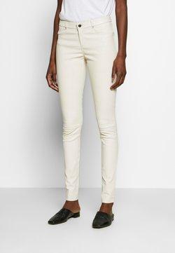 Ibana - TARTE TATIN - Pantalon en cuir - white