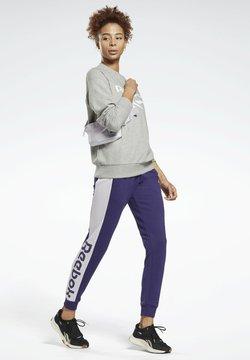 Reebok - LINEAR LOGO FRENCH TERRY JOGGERS - Jogginghose - purple