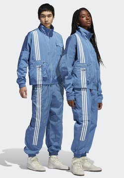 adidas Originals - IVY PARK NYLON TRACK PANTS (ALL GENDER) - Jogginghose - light blue