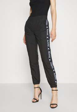 Karl Kani - TRACKPANTS - Jogginghose - black