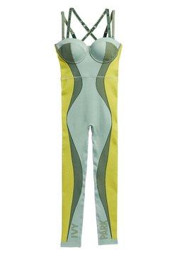 adidas Originals - IVY PARK CIRCULAR KNIT CATSUIT 2 - Jumpsuit - green tint/dark green/yellow tint