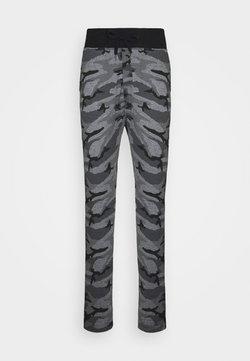 Schott - PAUL COMBAT - Pantalon de survêtement - black